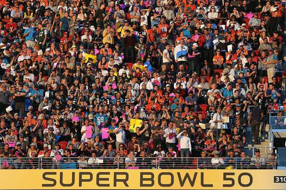 SANTA CLARA, CA - FEBRUARY 07:  Fans watch play between the Carolina Panthers and the Denver Broncos during the Pepsi Super Bowl 50 Halftime Show at Levi's Stadium on February 7, 2016 in Santa Clara, California.  (Photo by Patrick Smith/Getty Images)