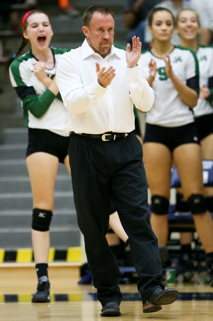 Reagan coach Mike Carter on the sideline during their UIL Class 6A third-round volleyball playoff match with O'Connor at Alamo Convocation Center on Nov. 10, 2015.