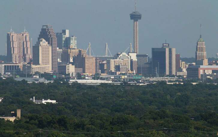 """A view of downtown from the North Side of San Antonio is shown in this 2016 photo. The city's ozone levels have finally triggered what local officials have long feared — a designation of """"non-attainment"""" by the Environmental Protection Agency."""