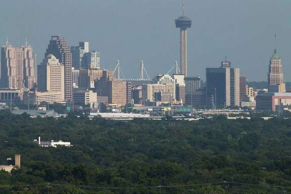 A view of downtown from the north on a hot day in 2016. Ground-level ozone, a primary component of smog, led to 52 premature deaths annually in San Antonio, according to a public health study by New York University and the American Thoracic Society.