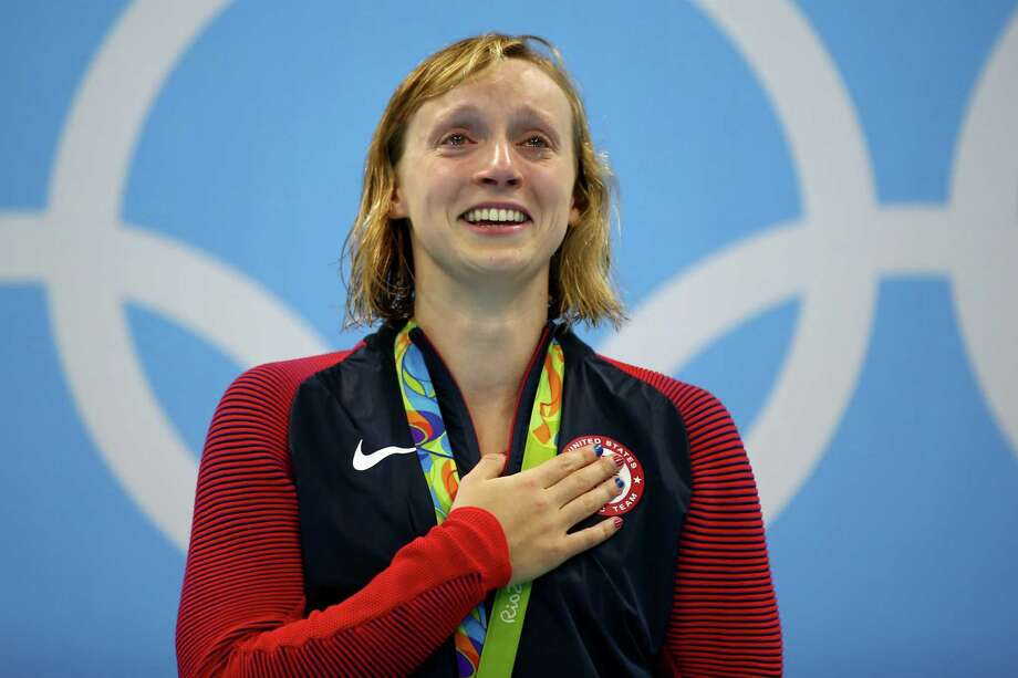 RIO DE JANEIRO, BRAZIL - AUGUST 12:  Katie Ledecky of United States celebrates on the podium after winning gold in the Women's 800m Freestyle Final on Day 7 of the Rio 2016 Olympic Games at the Olympic Aquatics Stadium on August 12, 2016 in Rio de Janeiro, Brazil. Photo: Clive Rose, Getty Images / 2016 Getty Images