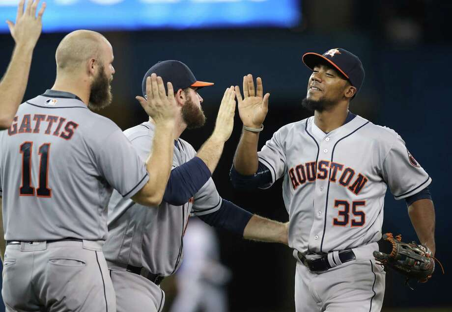 TORONTO, CANADA - AUGUST 12: Teoscar Hernandez #35 of the Houston Astros celebrates their victory with Tyler White #13 and Evan Gattis #11 during MLB game action against the Toronto Blue Jays on August 12, 2016 at Rogers Centre in Toronto, Ontario, Canada. Photo: Tom Szczerbowski, Getty Images / 2016 Getty Images