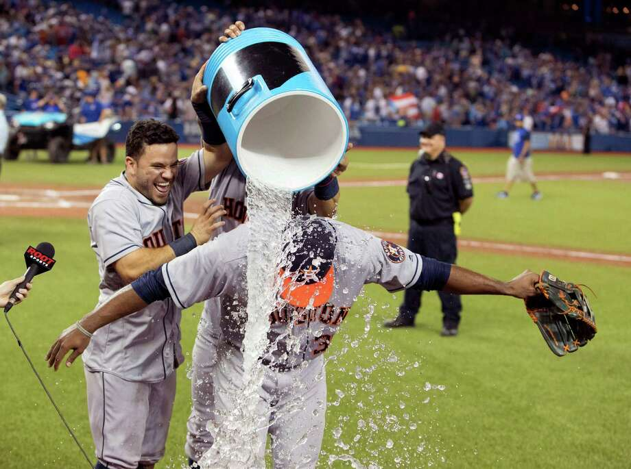 Houston Astros' Teoscar Hernandez is doused by teammates at the end of a baseball game against the Blue Jays in Toronto, Friday, Aug. 12, 2016. (Fred Thornhill/The Canadian Press via AP) Photo: Fred Thornhill, Associated Press / The Canadian Press