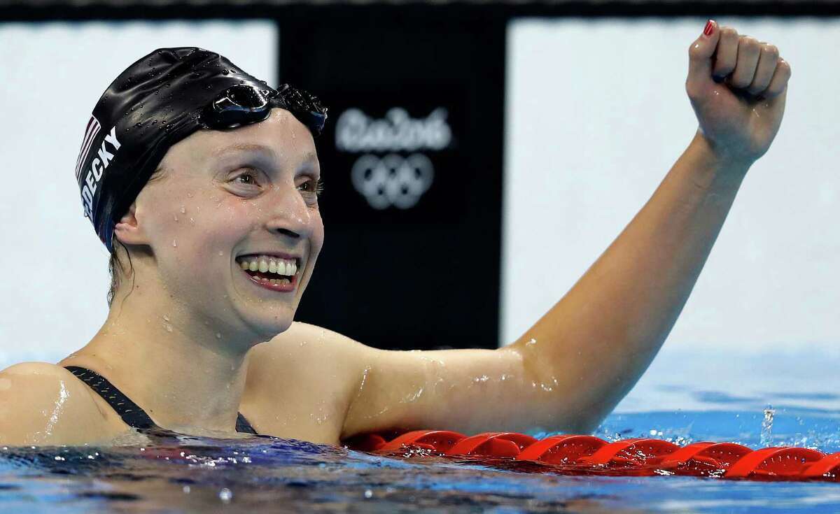 Katie Ledecky of the United States celebrates after winning the women's 800-meter freestyle final Friday at the Summer Olympics in Rio, breaking the world record in the process. Ledecky won the 200, 400 and 800 at the Rio Games.
