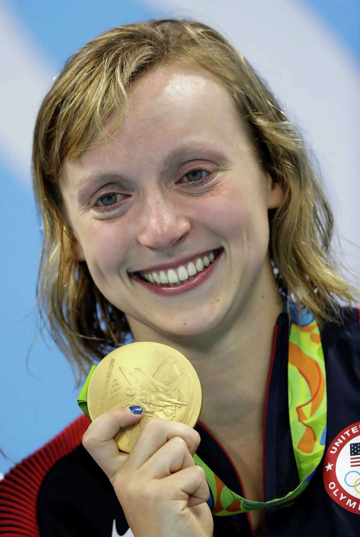 United States' Katie Ledecky, cries after winning gold, in the women's 800-meter freestyle medals ceremony during the swimming competitions at the 2016 Summer Olympics, Friday, Aug. 12, 2016, in Rio de Janeiro, Brazil. (AP Photo/Michael Sohn)