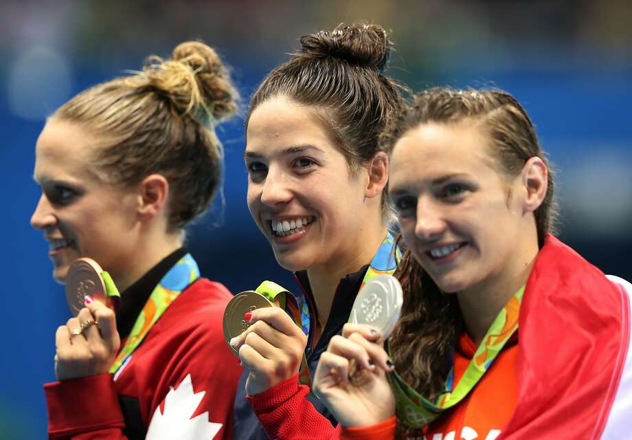 Canada's Hilary Caldwell, United States' Maya DiRado and Hungary's Katinka Hosszu, from left, in the women's 200-meter backstroke medals ceremony during the swimming competitions at the 2016 Summer Olympics, Friday, Aug. 12, 2016, in Rio de Janeiro, Brazil. (AP Photo/Lee Jin-man) Photo: Lee Jin-man, Associated Press