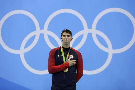 United States' Michael Phelps listens to the national anthem after he was awarded the gold medal during the ceremony for the men's 200-meter individual medley final during the swimming competitions at the 2016 Summer Olympics, Thursday, Aug. 11, 2016, in Rio de Janeiro, Brazil. (AP Photo/Michael Sohn)