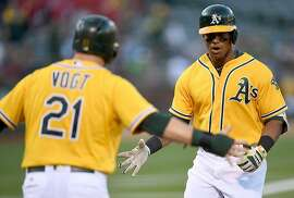 OAKLAND, CA - AUGUST 12:  Khris Davis #2 of the Oakland Athletics is congratulated by Stephen Vogt #21 after Davis hit a two-run homer against the Seattle Mariners in the bottom of the first inning at the Oakland Coliseum on August 12, 2016 in Oakland, California.  (Photo by Thearon W. Henderson/Getty Images)