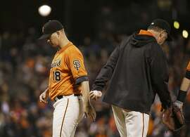 San Francisco Giants starting pitcher Matt Cain, left, walks to the dugout after being removed by manager Bruce Bochy, right, during the fifth inning of a baseball game against the Baltimore Orioles on Friday, Aug. 12, 2016, in San Francisco. (AP Photo/Eric Risberg)
