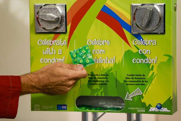 RIO DE JANEIRO, BRAZIL - JULY 23: A condoms' distribution machine at the Olympic and Paralympic Village for the 2016 Rio Olympic Games displaying the Olympic Rings in Barra da Tijuca. The Village will host up to 17,200 people amongst athletes and team officials during the Games and up to 6,000 during the Paralympic Games on July 22, 2016 in Rio de Janeiro, Brazil. (Photo by Buda Mendes/Getty Images)