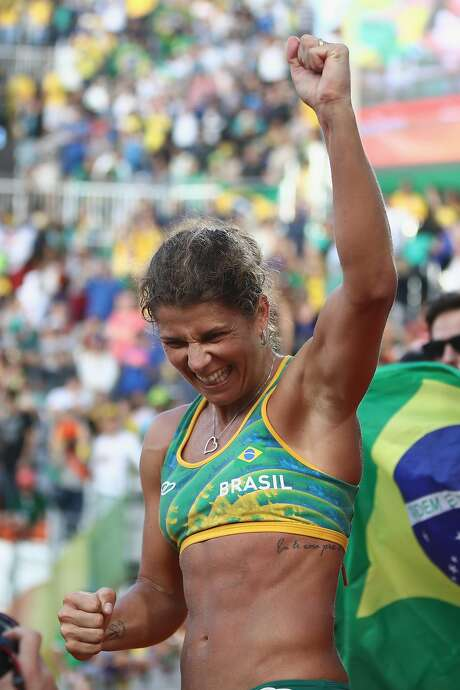 "Larissa Franca of Brazil is a medal favorite in beach volleyball. NBC announcer Chris Marlowe called her wife, Liliane Maestrini, her ""husband"" when cameras showed the two embracing after Franca's win. Photo: Buda Mendes, Getty Images"