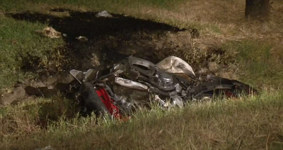 A 32-year-old died early Saturday, August 13, after his motorcycle hit a car that had lost control and came into his lane of oncoming traffic in northeast Houston. Photo: Metro Video
