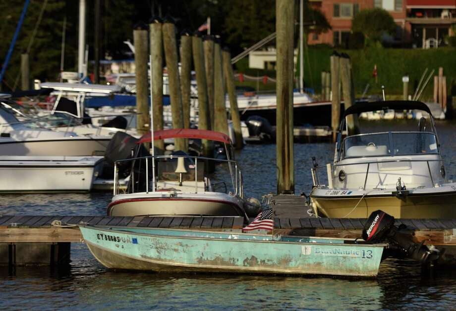 Boats are docked at the Grass Island Marina in Greenwich Harbor in Greenwich. Photo: Tyler Sizemore / Hearst Connecticut Media / Greenwich Time