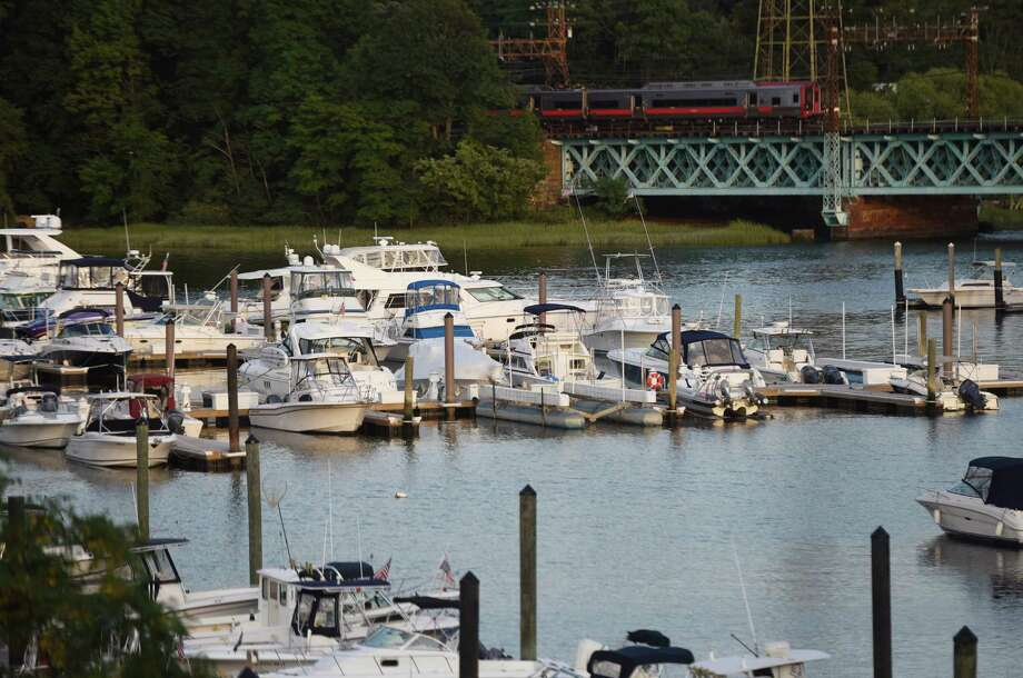 FILE: Boats are docked in the Cos Cob Harbor at sunset in the Cos Cob section of Greenwich, Conn.  Photo: Tyler Sizemore / Hearst Connecticut Media / Greenwich Time