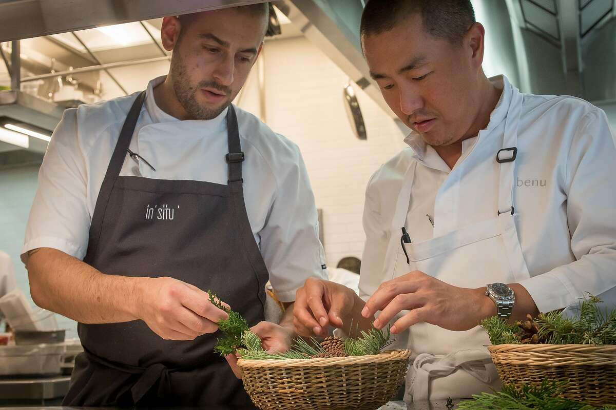 Corey Lee (right) and chef Brandon Rodgers put together the basket for the fried chicken at In Situ.