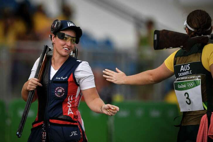 Bronze medallist US Corey Cogdell (L) is congratulated by gold medal winner Australia's Catherine Skinner during the women's trap event at the Rio 2016 Olympic Games at the Olympic Shooting Centre in Rio de Janeiro on August 7, 2016. / AFP PHOTO / PHILIPPE LOPEZPHILIPPE LOPEZ/AFP/Getty Images