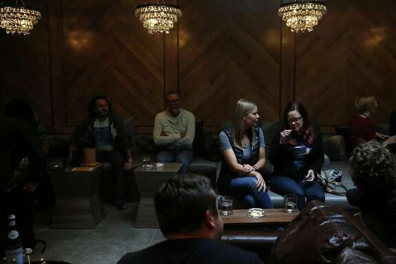 Ruby LaGrandeur, center left, and Lauren Woodman chat and Woodman tries a vaping device as they wait for Frenchy Cannoli to start his presentation on hashish in Harvest's private, members-only cannabis lounge August 12, 2016 in San Francisco, Calif.