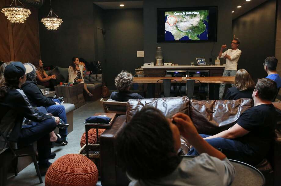 People listen as Frenchy Cannoli makes a presentation about a hashish product at pot dispensary Harvest's members-only cannabis lounge in San Francisco. Photo: Leah Millis, The Chronicle