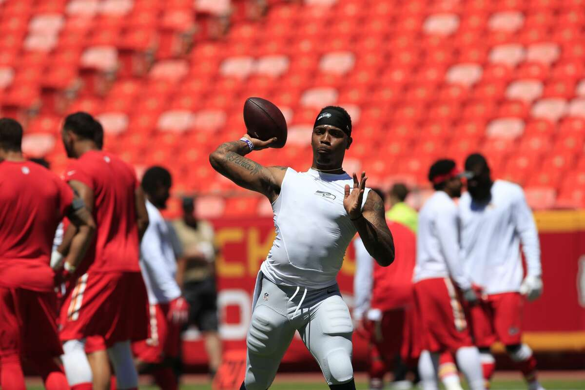 Seattle Seahawks quarterback Trevone Boykin (2) throws before an NFL preseason football game against the Kansas City Chiefs in Kansas City, Mo., Saturday, Aug. 13, 2016. (AP Photo/Orlin Wagner)