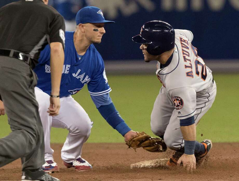Houston Astros' Jose Altuve is tagged out stealing second by Toronto Blue Jays shortstop Troy Tulowitzki during the third inning of a baseball game in Toronto, Saturday, Aug. 13, 2016. (Fred Thornhill/The Canadian Press via AP) Photo: Fred Thornhill, Associated Press / CP
