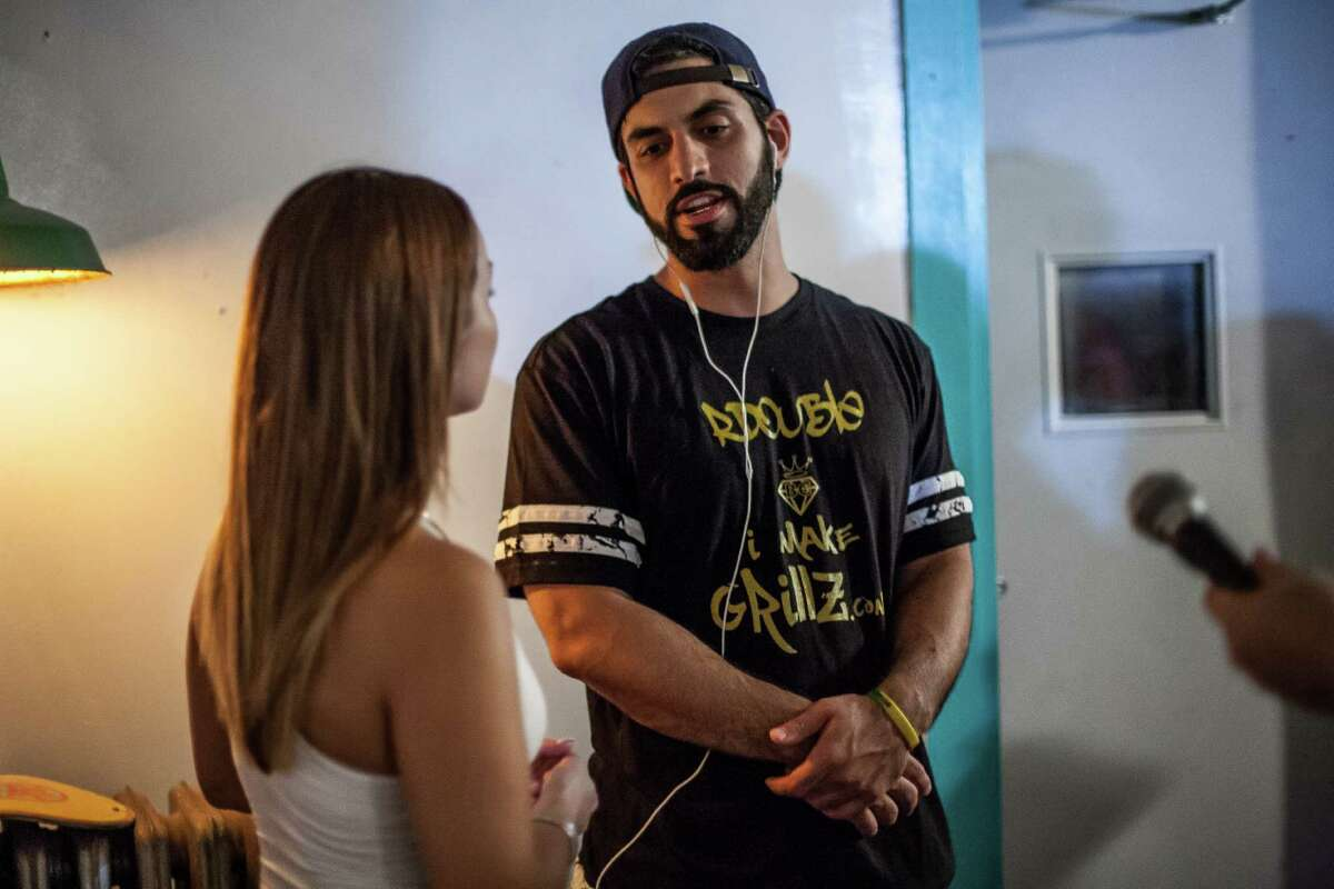 Roosh Williams is interviewed during a show at The Safehouse Friday August 12, 2016. The show, possibly Williams' last in Houston, is in celebration of him moving to California.