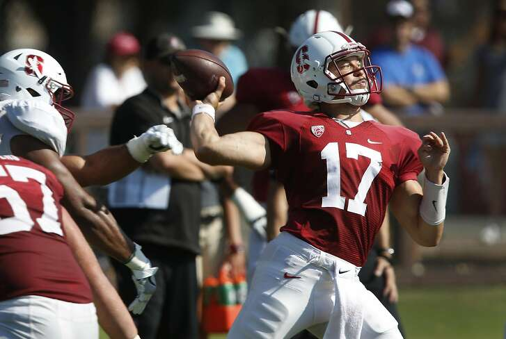 Quarterback Ryan Burns throws a pass at a Stanford Cardinal football practice in Stanford, Calif. on Saturday, Aug. 13, 2016.