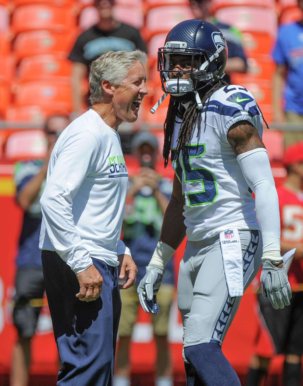 Seattle Seahawks head coach Pete Carroll talks as he walks behind cornerback Richard Sherman (25) before an NFL preseason football game against the Kansas City Chiefs in Kansas City, Mo., Saturday, Aug. 13, 2016. (AP Photo/Ed Zurga)