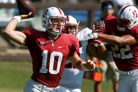Quarterback Keller Chryst throws a pass at a Stanford Cardinal football practice in Stanford, Calif. on Saturday, Aug. 13, 2016.