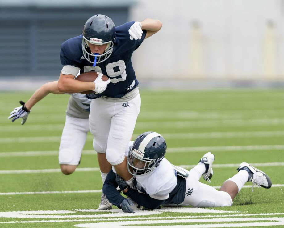 Jorian Clark (20) of the Rice Owls tackles T.J. Gotelli (89) after a short reception in an inter squad scrimmage on Saturday, August 13, 2016 at Rice Stadium in Houston Texas. Photo: Wilf Thorne, For The Chronicle / © 2016 Houston Chronicle
