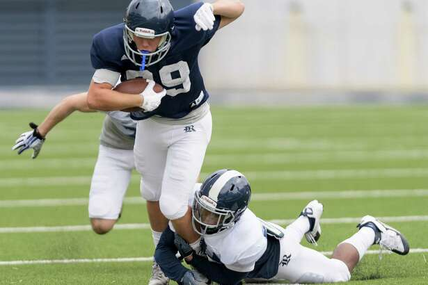 Jorian Clark (20) of the Rice Owls tackles T.J. Gotelli (89) after a short reception in an inter squad scrimmage on Saturday, August 13, 2016 at Rice Stadium in Houston Texas.