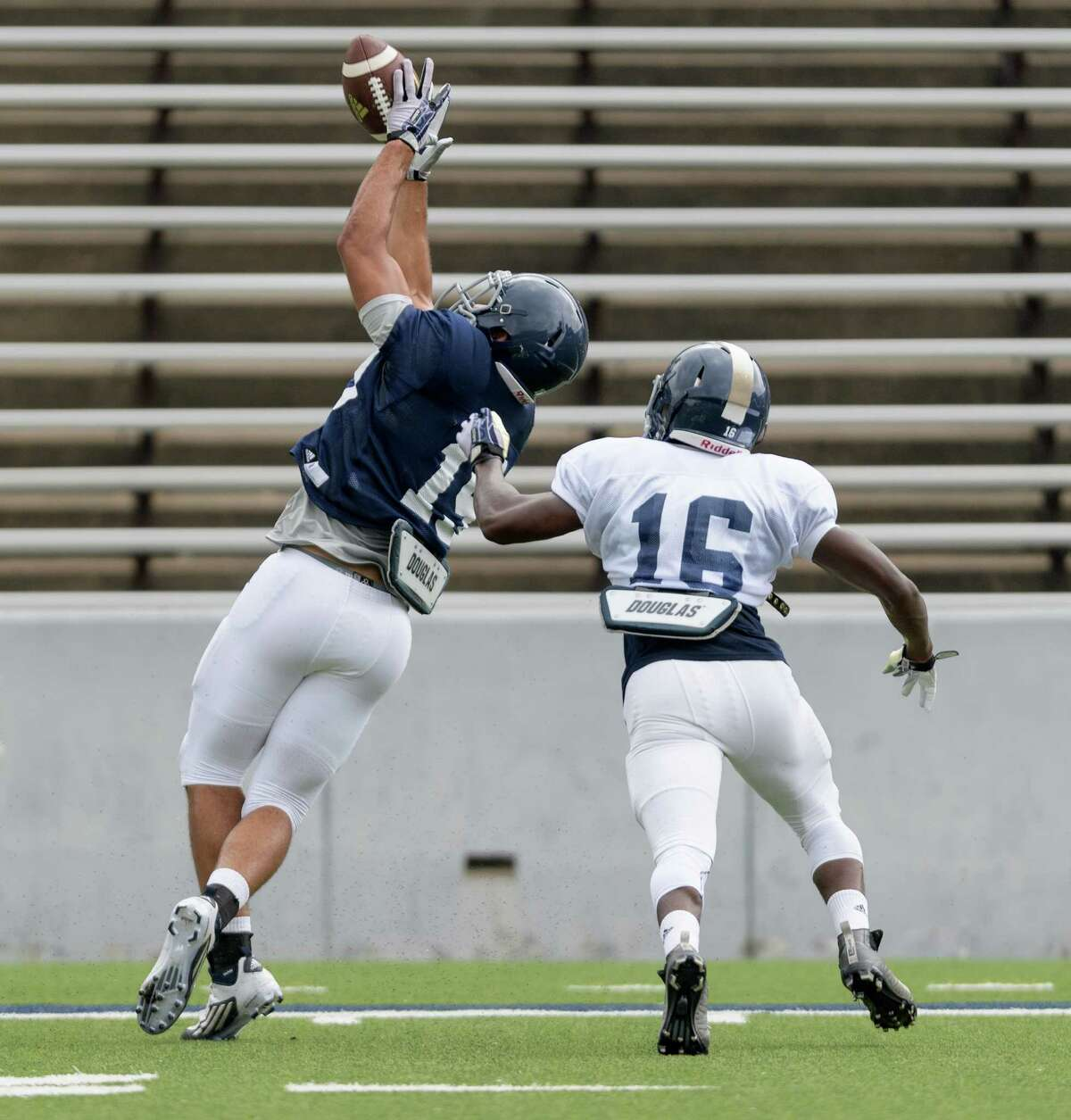 Kylen Grayson (19) of the Rice Owls attempts a reception over Josh Cummings (16) in an inter squad scrimmage on Saturday, August 13, 2016 at Rice Stadium in Houston Texas.
