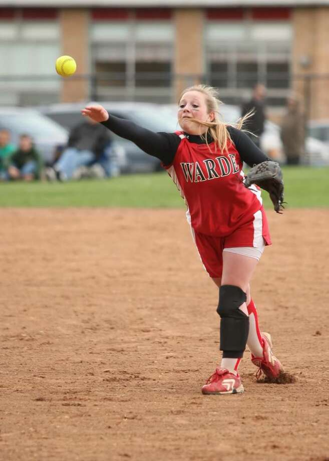 Fairfield Warde's Heather Vanderheyden fires to first base in the Mustangs' 4-2 loss to Westhill on Wednesday at Warde. Photo: Todd Kalif, Todd Kalif For The Fairfield Citizen