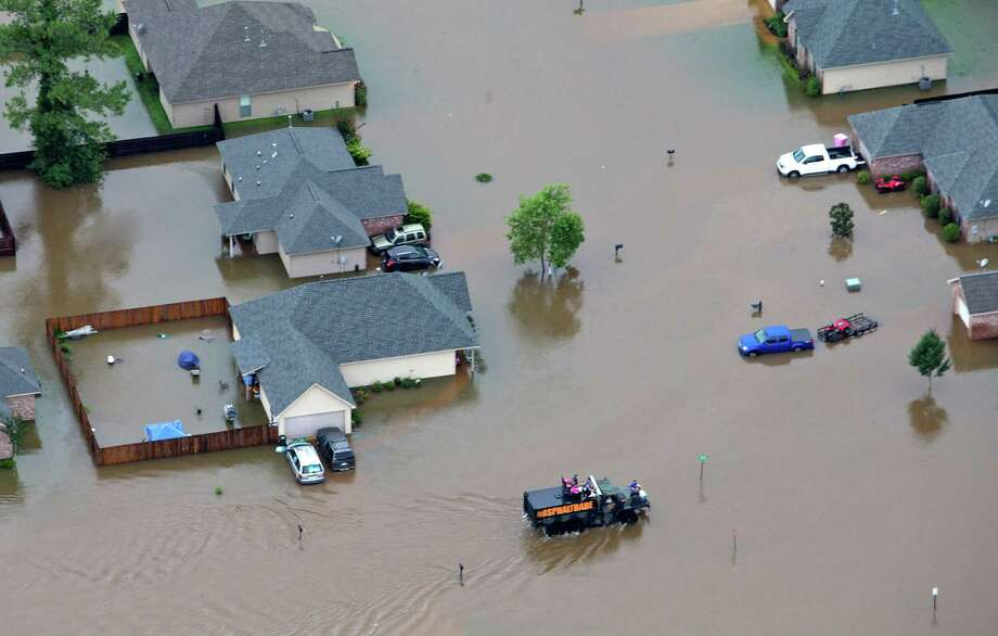 In this aerial photo, rescue officials and civilians alike work to pull people from their flooded homes along the flooded Tangipahoa River near Amite, Independence, Tickfaw and Robert, Louisiana Saturday, August 13, 2016. (Ted Jackson/Nola.com | The Times-Picayune) Photo: Ted Jackson, AP / NOLA.com The Times-Picayune
