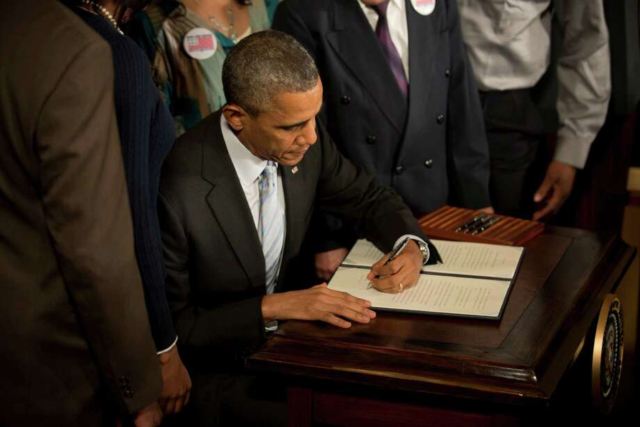 FILE -- President Barack Obama signs an executive order regarding the minimum wage for federal contractors, at the White House in Washington, Feb. 12, 2014. Once skeptical of executive power, Obama has come to embrace it — in the process creating the kind of government neither he nor the Republicans wanted. (Stephen Crowley/The New York Times)  ORG XMIT: XNYT42 Photo: STEPHEN CROWLEY / NYTNS