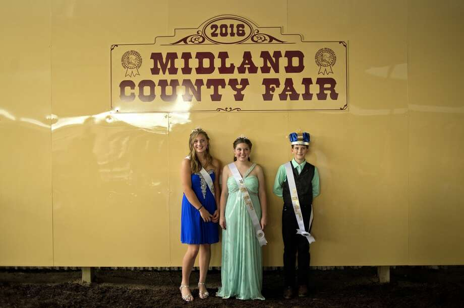 From left, 2016 Midland County Fair royalty princess Audrey Martin, queen Jordan McRoberts and prince Hunter Buczek stand for pictures during the Midland County Fair Royalty Contest on Saturday at the Midland County Fairgrounds. There were no king contestants registered for this year's contest. Photo: NICK KING | Nking@mdn.net