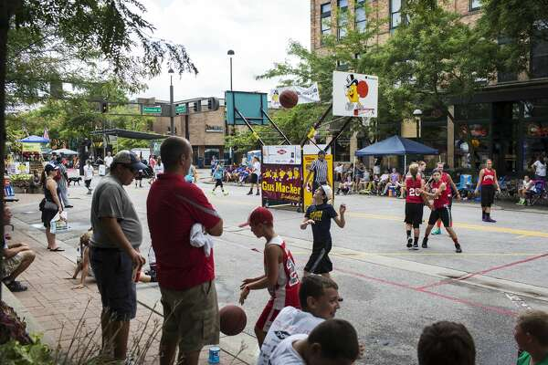 Participants in the third annual Gus Macker 3-on-3 basketball tournament compete along Main Street in downtown Midland on Saturday.