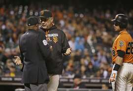 San Francisco Giants manager Bruce Bochy argues with home plate umpire Alan Porter after Giants' Buster Posey, right, struck out swinging during the ninth inning of a baseball game against the Baltimore Orioles on Friday, Aug. 12, 2016, in San Francisco. Baltimore won 5-2. (AP Photo/Eric Risberg)
