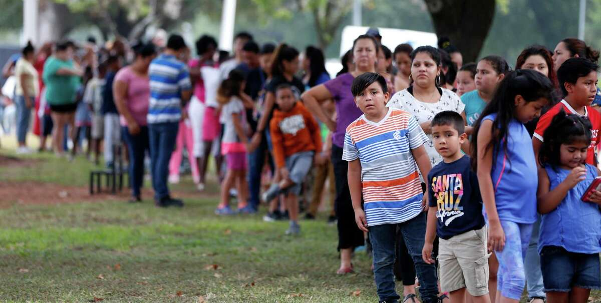 People wait to get into the 6th Annual Mayor's Back 2 School Fest as the line to get in wrapped around the park area a couple of times. The fest, presented by Shell Oil Company and hosted by University of Houston drew thousands of people, Saturday, Aug. 13, 2016, in Houston.