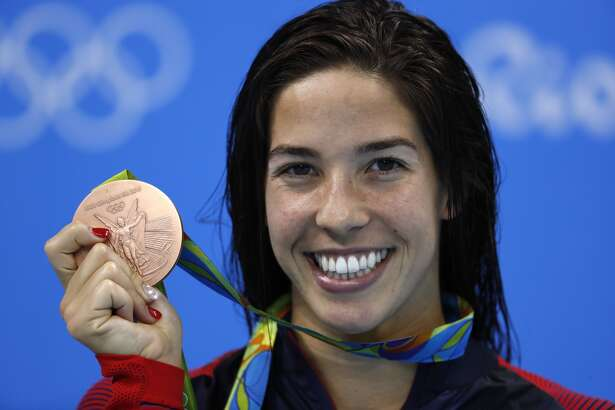 USA's Madeline 'Maya' Dirado poses with her bronze medal on the podium of the Women's 200m Individual Medley Final during the swimming event at the Rio 2016 Olympic Games at the Olympic Aquatics Stadium in Rio de Janeiro on August 9, 2016. / AFP / Odd Andersen (Photo credit should read ODD ANDERSEN/AFP/Getty Images)