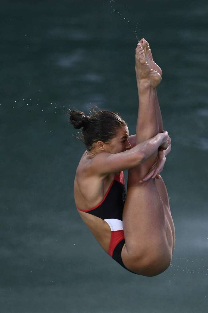 US Kassidy Cook competes in the Women's 3m Springboard Semifinal during the diving event at the Rio 2016 Olympic Games at the Maria Lenk Aquatics Stadium in Rio de Janeiro on August 13, 2016.   / AFP PHOTO / Martin BUREAUMARTIN BUREAU/AFP/Getty Images