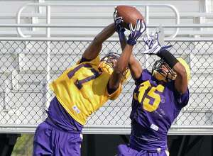 UAlbany wide receiver #17 Tre Hopkins, left, completes a pass as cornerback #35 Ty Tobias defends during practice at Casey Stadium Saturday Aug. 13, 2016 in Albany, NY.  (John Carl D'Annibale / Times Union)