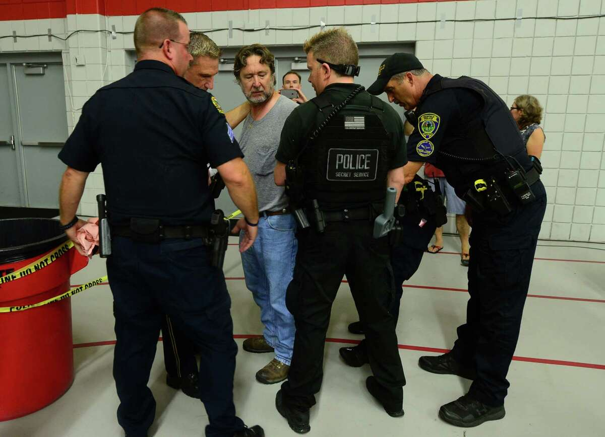 A supporter is detained by police at the Trump Rally at Sacred Heart University Saturday, August 13, 2016 in Fairfield, Conn.