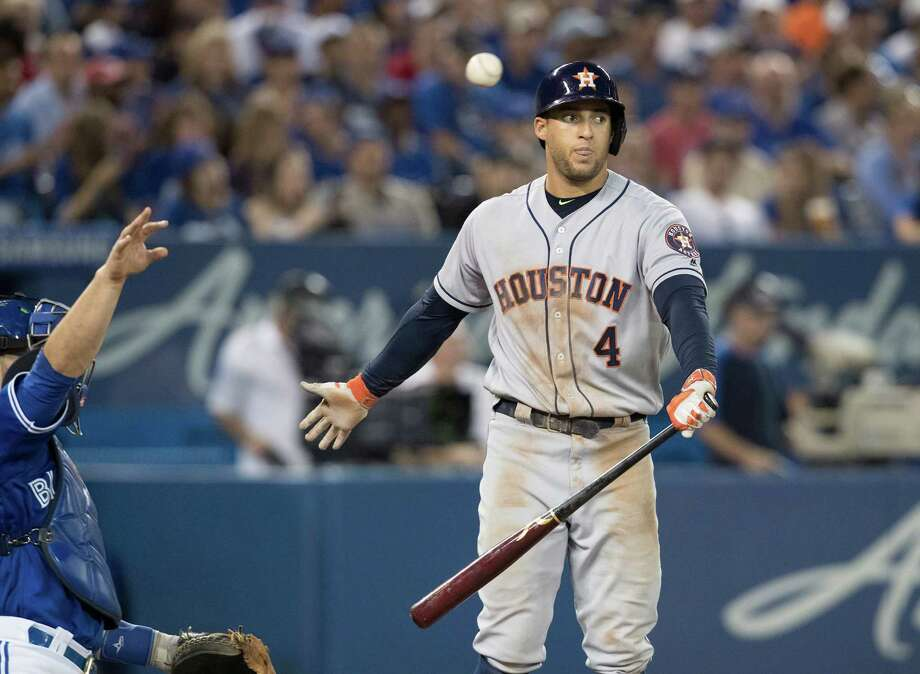 George Springer doesn't like the called strike in the eighth inning, but the Astros right fielder struggled at the plate Saturday with three strikeouts and one walk in a 4-2 loss to the Blue Jays in Toronto. Photo: Fred Thornhill, SUB / CP
