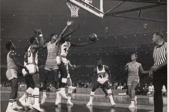 01/20/1968 - UH v UCLA MENS BASKETBALL -- Elvin Hayes grabs a rebound from UCLA's Lew Alcindor in their Astrodome match. Jan. 20, 1968. Alcindor later known as Kareem Abdul-Jabbar.