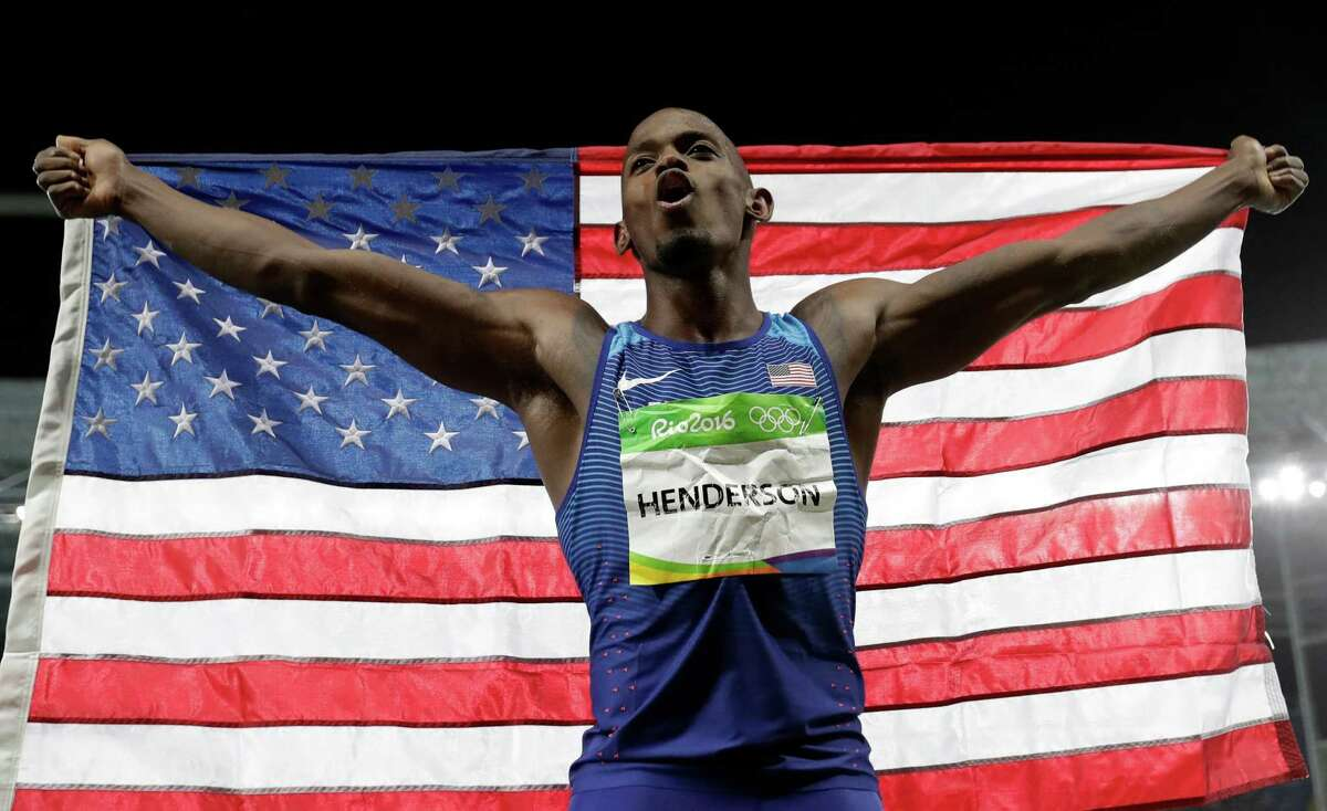 Jeff Henderson celebrates his dramatic achievement Saturday. His sixth and final jump proved to be the winner for the American, whose 27-6 leap outdistanced his foes and captured the gold medal in the long jump in Rio de Janeiro.