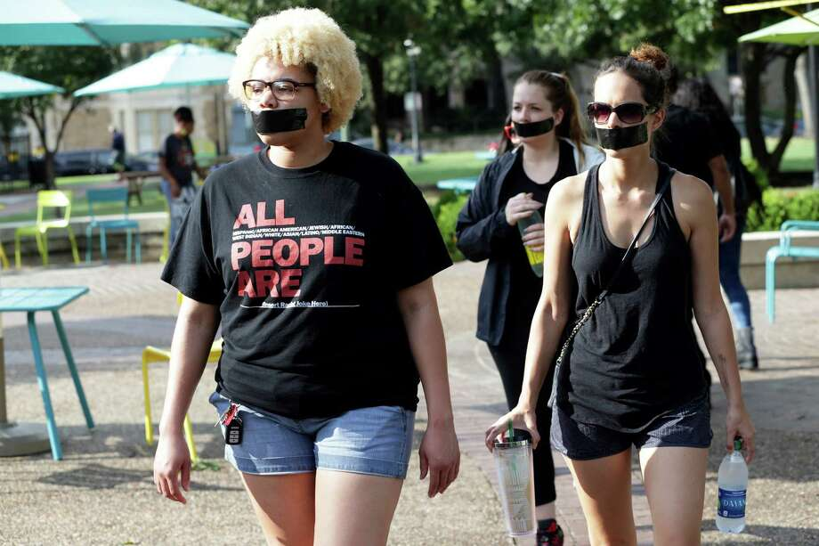 Marches walk into the Travis Park where local activists conduct a silent protest to express their views about police interaction on August 13, 2016 Photo: TOM REEL, SAN ANTONIO EXPRESS-NEWS / 2016 SAN ANTONIO EXPRESS-NEWS