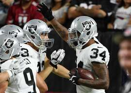 GLENDALE, AZ - AUGUST 12:  George Atkinson III #34 and teammate Max McCaffrey #83 of the Oakland Raiders celebrate a touchdown during the second half against the Arizona Cardinals at University of Phoenix Stadium on August 12, 2016 in Glendale, Arizona. Raiders won 31-10.  (Photo by Norm Hall/Getty Images)