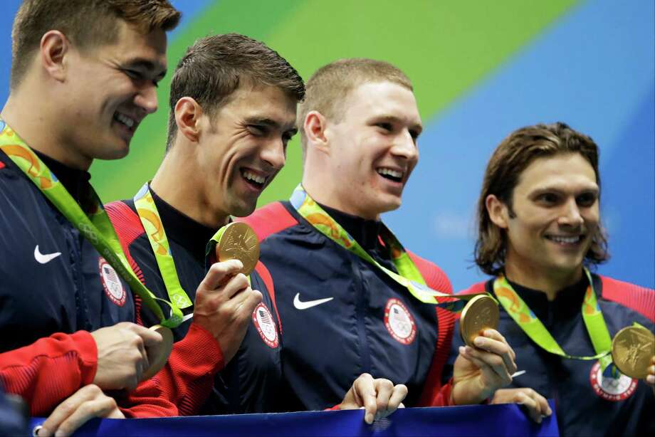 From right to left, United States' Cody Miller, Ryan Murphy, Michael Phelps and Nathan Adrian display their medals during the medal ceremony for the men's 4 x 100-meter medley relay final during the swimming competitions at the 2016 Summer Olympics, Sunday, Aug. 14, 2016, in Rio de Janeiro, Brazil. ((AP Photo/Rebecca Blackwell) Photo: Rebecca Blackwell, Associated Press / Copyright 2016 The Associated Press. All rights reserved. This material may not be published, broadcast, rewritten or redistribu
