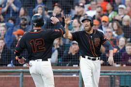 SAN FRANCISCO, CA - AUGUST 13: Hunter Pence (R) #8 of the San Francisco Giants celebrates with Joe Panik #12 of the San Francisco Giants after scoring on a single hit by Denard Span #2 of the San Francisco Giants in the second inning during an interleague game against the Baltimore Orioles at AT&T Park on August 13, 2016 in San Francisco, California. (Photo by Lachlan Cunningham/Getty Images)