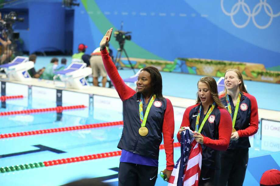 From left: Simone Manuel, Kathleen Baker and Lilly King of the U.S. after receiving the gold medal during the 2016 Summer Olympics in Rio de Janeiro, Aug. 13, 2016. The U.S. took home the gold medal in the women's 4x100-meter medley relay. (Chang W. Lee/The New York Times) Photo: CHANG W. LEE, NTY / NYTNS